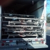 Members of SBH driving a U-HAUL truck full of equipment to the storage